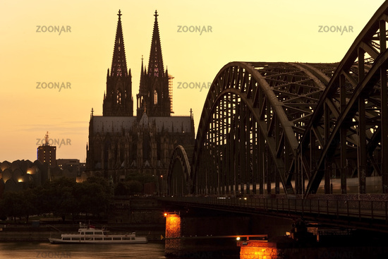 Cologne Cathedral with Hohenzollern Bridge at the sunset, Cologne, North Rhine-Westphalia, Germany