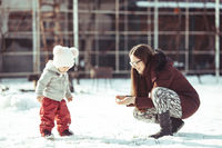 Winter walking mom and baby