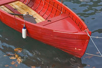 Detail of a rowboat in red color