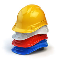 Various hard hats, safety helmets isolated on white.