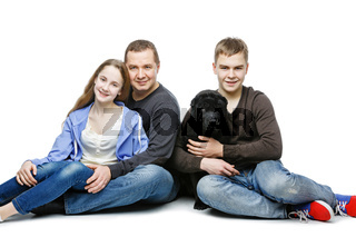Father with children sitting  dog