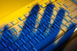 Keyboard and shadow. Data theft.