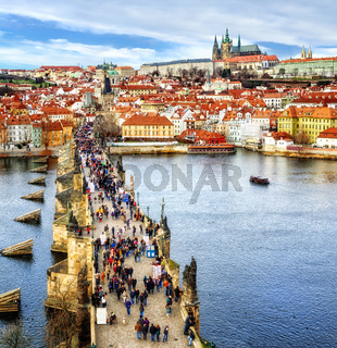 Panorama of Prague with the Castle, Charles Bridge, Vltava river and red roofs of the old town, Czech Republic