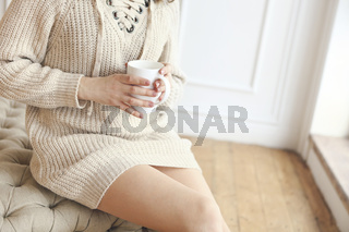 Young pretty woman drinking coffee in the morning