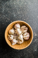 Fresh healthy garlic in wooden bowl.
