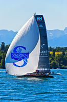 Sailing boat flying a spinnaker sail on Lake Geneva, Geneva, Switzerland