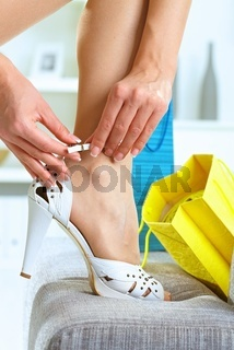 Woman fitting high heel shoes
