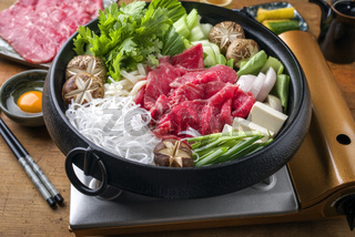 Traditional Japanese Sukiyaki with Kobe Beef as close-up in a Pot