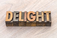 delight word abstract in wood type