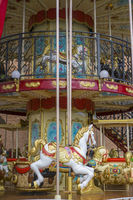Circus, merry-go-round, beautiful game for children with colorful horses and fun in an outdoor park