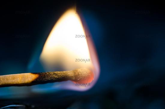 One Burning match macro, on black background