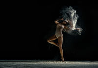 Amazing photo of graceful woman dancing with dust