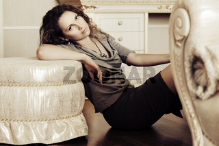 Beautiful fashion woman relaxing at apartment