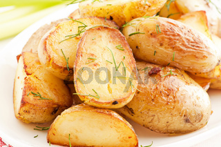 Roast Potatos as closeup on a white plate