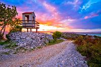 Lookout tower above Pakostane archipelago at golden sunset