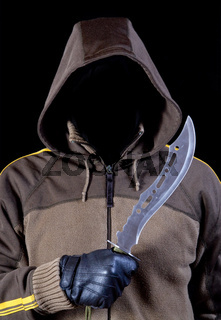 invisible face in a hood with knife