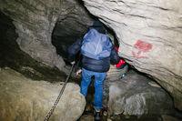 children explore underground caves, an underground karst complex of Cunardo, Lombardy, Italy