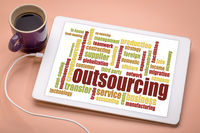 outsourcing word cloud on a tablet