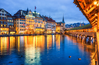 Lucerne, Switzerland, view of the old town from wooden Chapel bridge in the evening