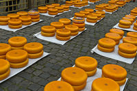 Gouda cheese wheels piled up on the cheese market, Gouda, Netherlands