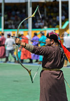 Female archer in traditional deel costumes, women's archery competition, Naadam Festival,