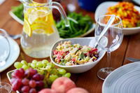 vegetable salad in bowl and other food on table