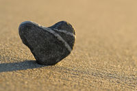 stone heart on a beach in the morning