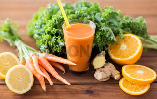 glass of carrot juice, fruits and vegetables