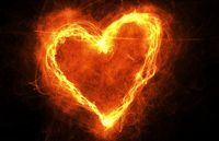 Burning heart in dark. Heart-shaped ring of fire with copyspace. Frame for love, romance and Valentines Day Card