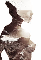 Silhouette of a naked woman combined with a tropical beach and sea. Double exposure. Toned image