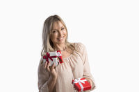 Woman holding wrapped gifts presents birthdays Christmas