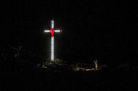 Illumination of a cross with red heart