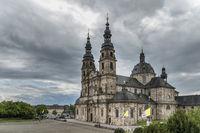The Fulda Cathedral under dense clouds.