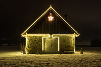 Small cottage with fairy lights at night and snow, Malters, Lucerne, Switzerland, seasons