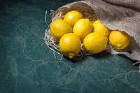 Lemons spilling from a jute sack