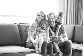 happy young couple spending time with kids