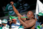 Soccer fan blowing a Vuvuzela