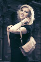 Happy young fashion woman with handbag