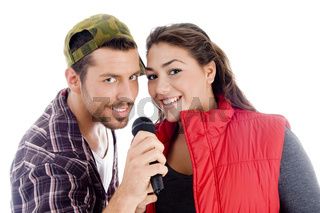 young male and female singer with microphone