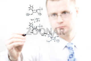 young chemist writing organic chemistry reaction equation