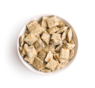 Breakfast cereal squares in bowl.