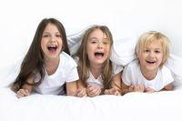 Three children waking up