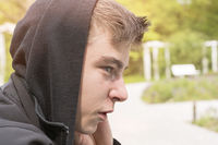 profile portrait of a young man with black hoodie