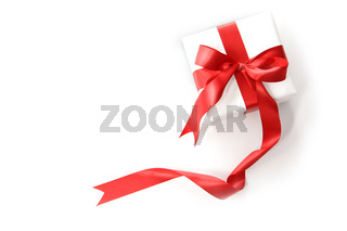 Red ribbon gift on white