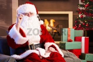 Portrait of Santa Claus by fireplace
