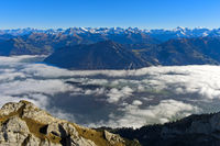 View from the Pilatus massif across the sea of fog on the Swiss Alps mountain range, Switzerland