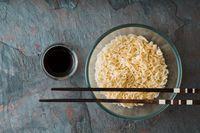 Soup Ramen noodles in glass bowl on tte blue background