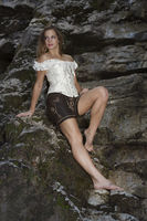 Young Woman on rock slab