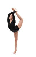 Young blonde gymnast in black exercising in studio