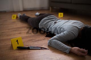 dead woman body lying on floor at crime scene